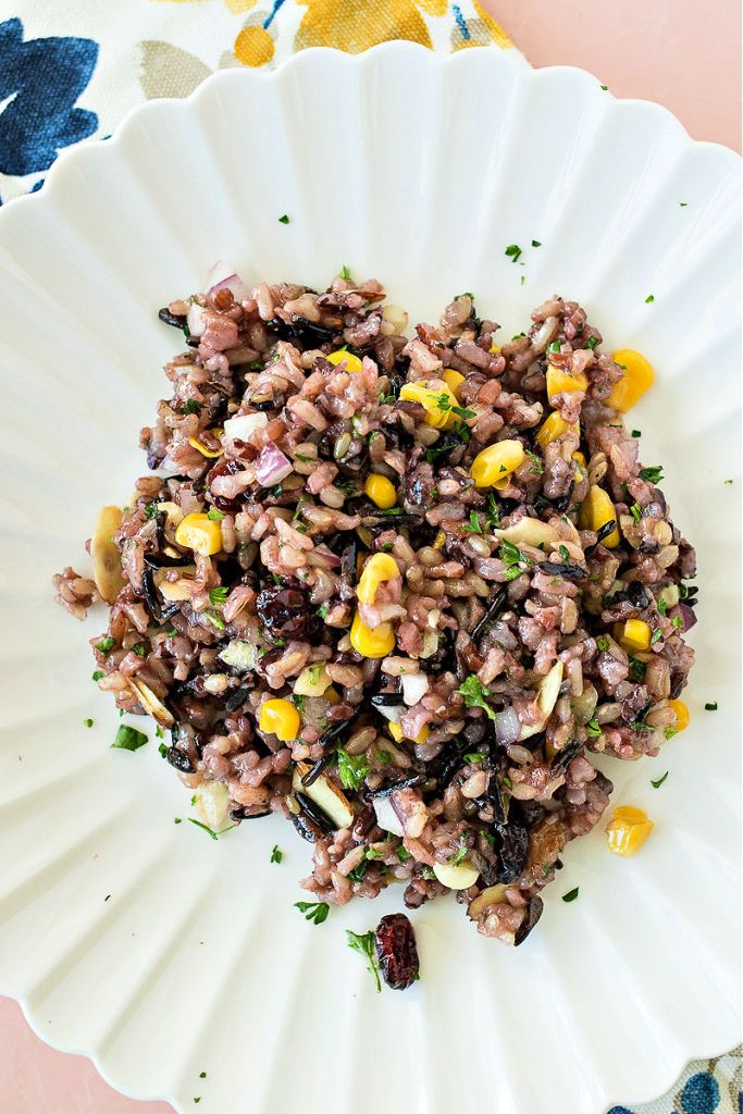 overhead shot of wild rice salad on a white plate