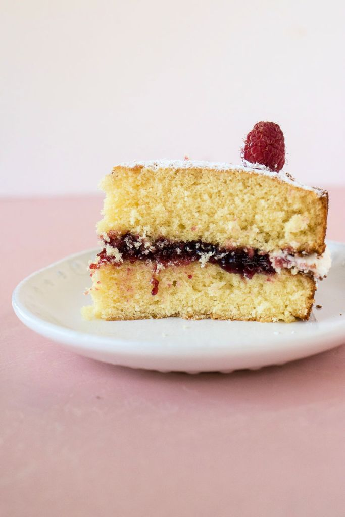 slice of victoria sandwich cake from the side so you can see all the layers