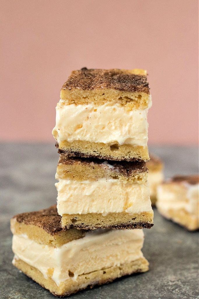 three snickerdoodle ice cream sandwiches stacked on one another