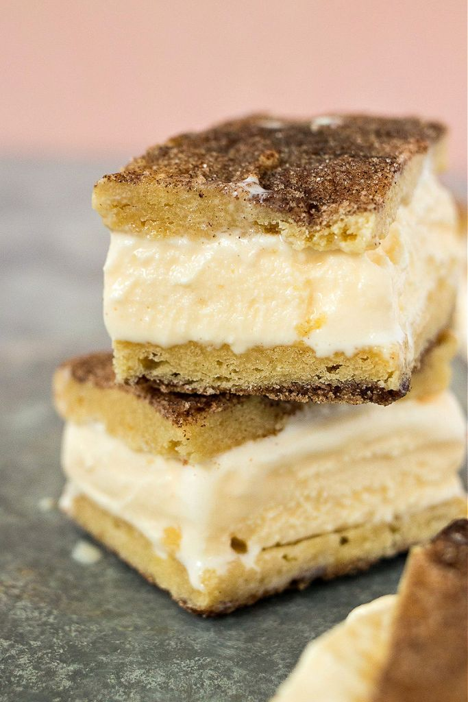 two snickerdoodle ice cream sandwiches stacked on top of each other