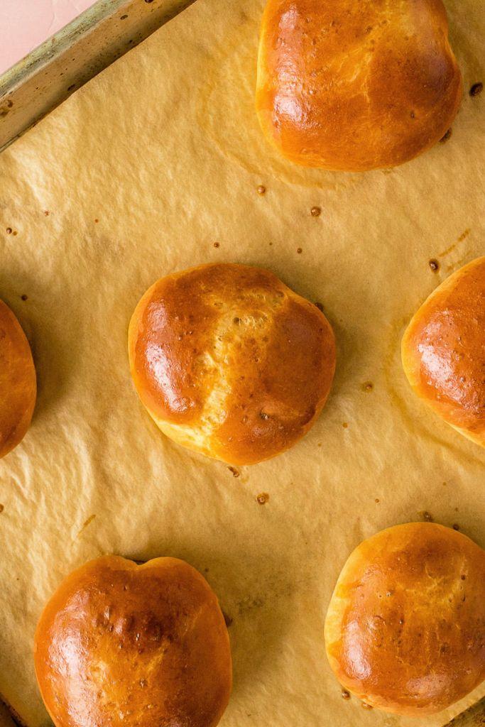 overhead shot of brioche au chocolat buns on a baking sheet