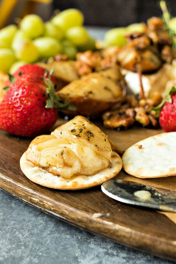 baked brie spread on a cracker