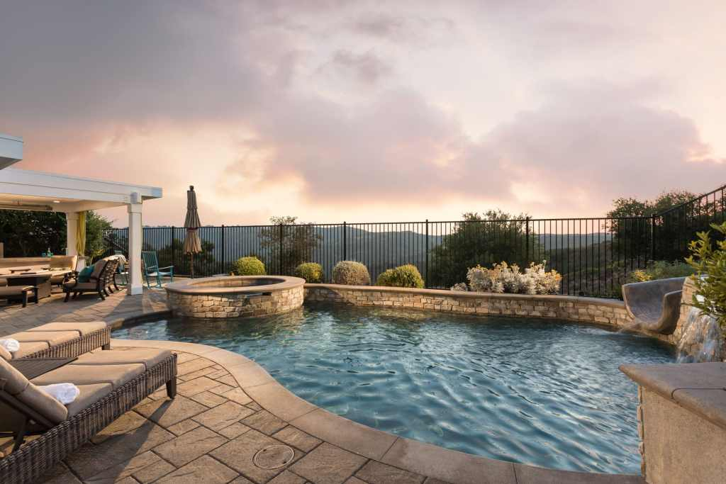 Pool/Spa home with cotton candy sky sunset.