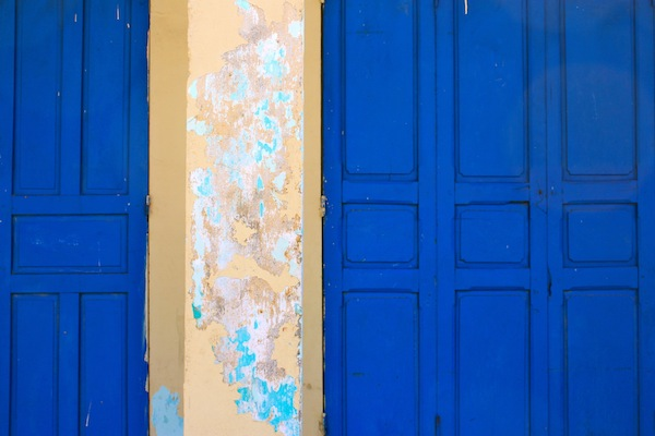 Blue door and cream column in Hoi An, Vietnam