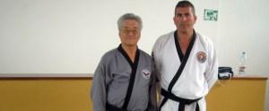 Juan Carlos Pulido, a la derecha, seguirá al frente del taekwondo ceutí