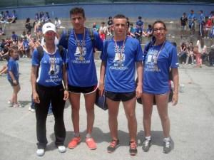 Los cuatro atletas ceutíes, con sus respectivas medallas