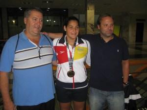 Aguilera junto a Lorena Miranda y Miguel Ángel Ríos cuando la campeona del mundo llegó a la ciudad autónoma