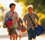 """CASA's """"Pack with Pride"""" program - image of boys walking"""