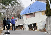 disaster relief - image of sinking house