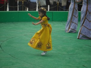 little girl dancing with trick riders