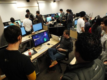 A group of jammers gather around to play one of the games.