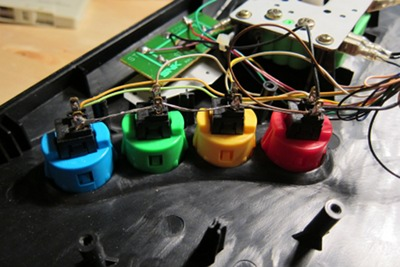 The signal wires attached to each contact post. Each button tied together with a grounding wire, which is then tied in with the other 3 ground wires.