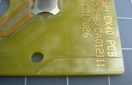 The PCB after a few passes have been made with a utility knife. It takes quite some time to make progress, so just keep at it.