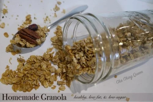 Homemade Granola with Spoon Spilling Out of Mason Jar