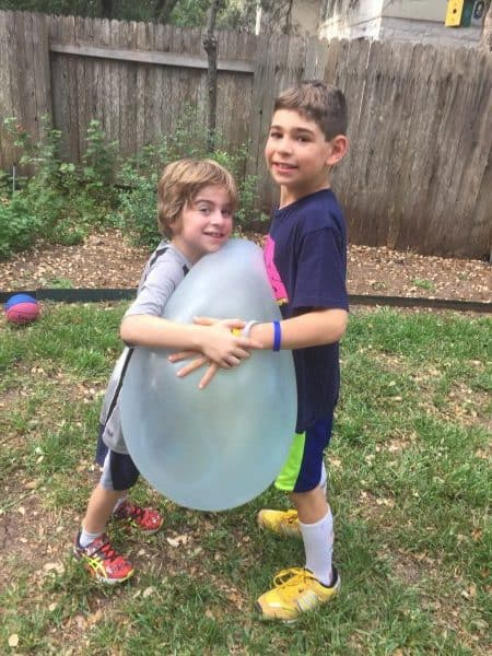 Super Wubble Ball product Review blog post with kids ages 8 and 10 outside