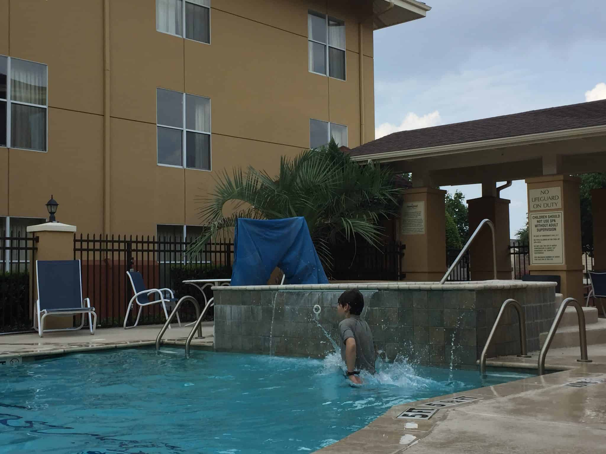 Extended Stay America for Family Friendly and Pet Friendly Travel kids in the pool