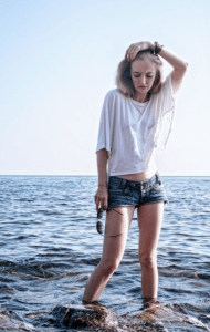 denim shorts girl in the ocean