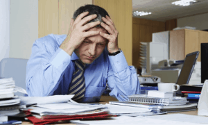 How Lack of Sleep Can Affect Your Business man office hands head