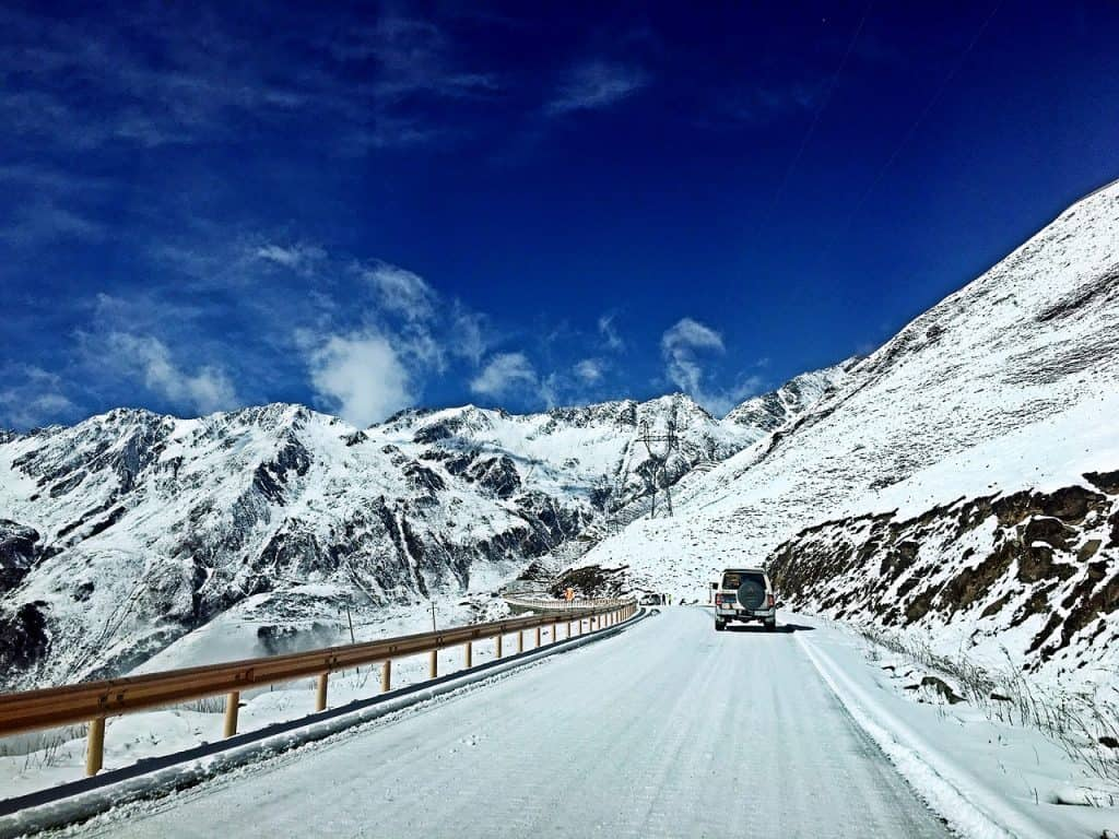 drive safe icy road conditions on highway mountains - Family Travel: Safe Winter Driving Tips and Winter Road Safety