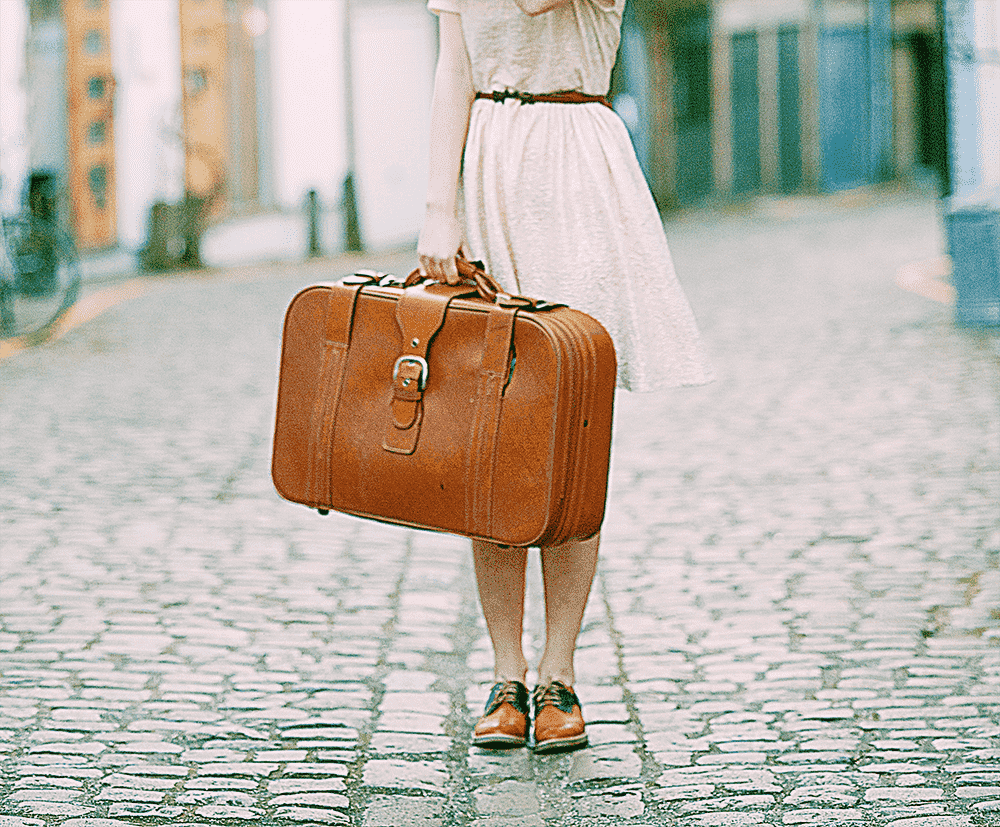 packing travel tips - woman with suitcase