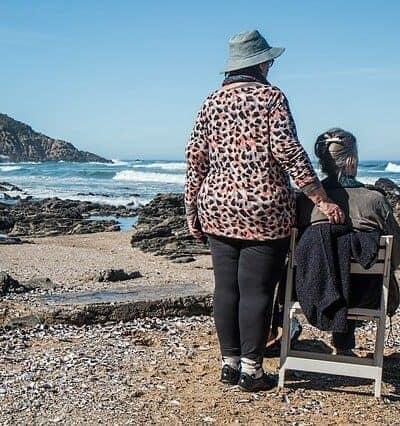 women friends elderly at ocean