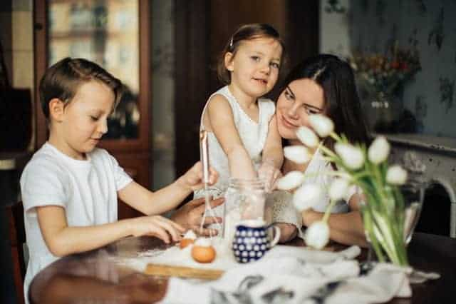 photo-of-woman-sitting-with-her-children-3806958