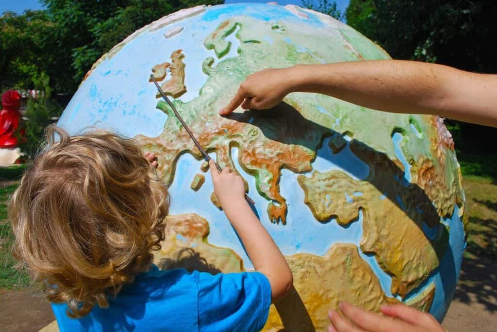 learning kid at earth globe
