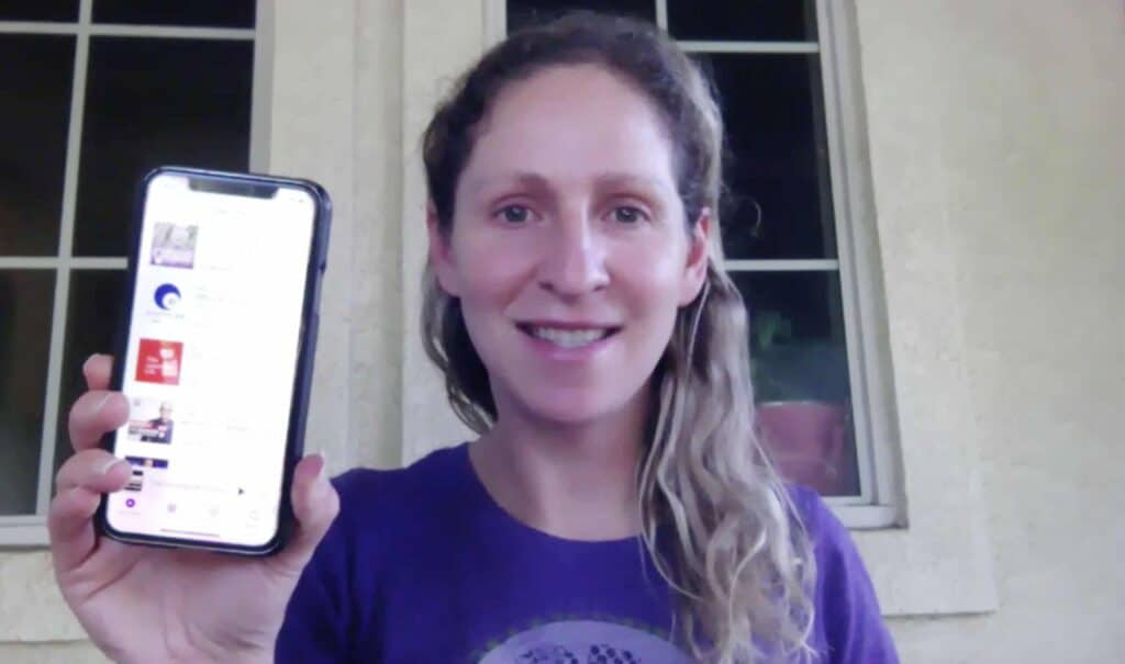 woman with iphone podcasts