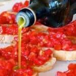 tuscan bruschetta recipe - pouring olive oil