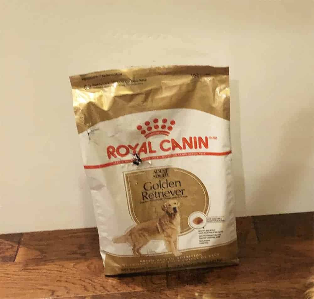 royal canin golden retriever dog food hole in bag from cat