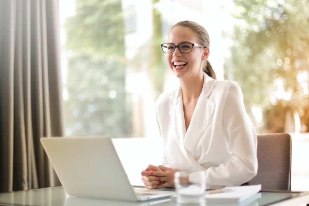 woman working on computer smiling