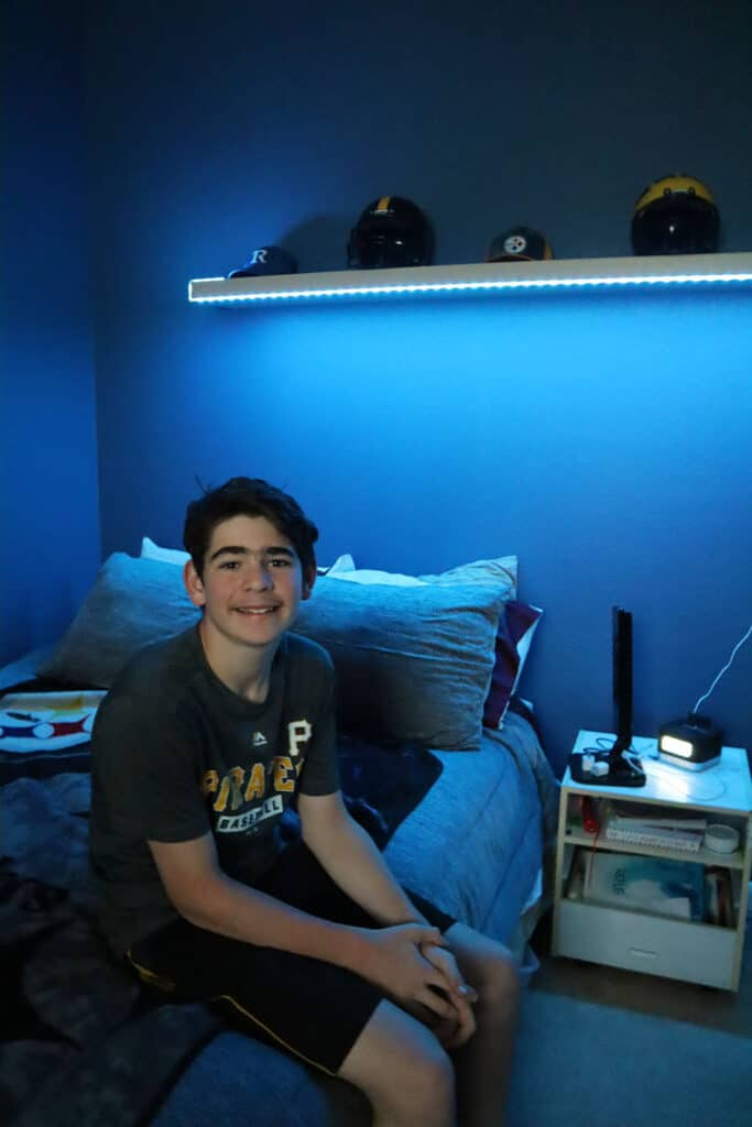 teen boys room with lights under shelf