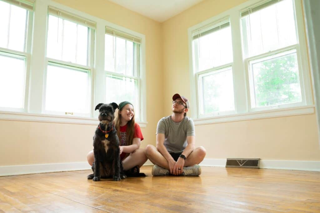 inside the house couple in the home with dog