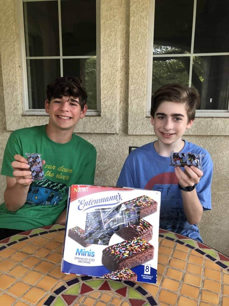boys enjoying Entenmann's Minis Sprinkled Iced Brownies #SprinklefestGiveaway with #Entenmanns