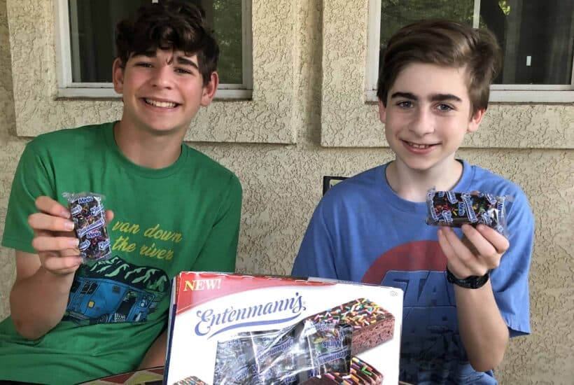 boys enjoying Entenmann's Minis Sprinkled Iced Brownies