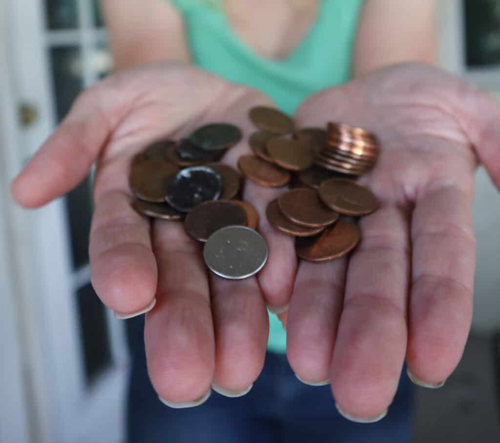 coins in hand for coinstar