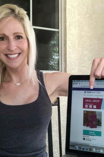 Austin Lifestyle Blogger Rachel Belkin holding on laptop with Tophatter website
