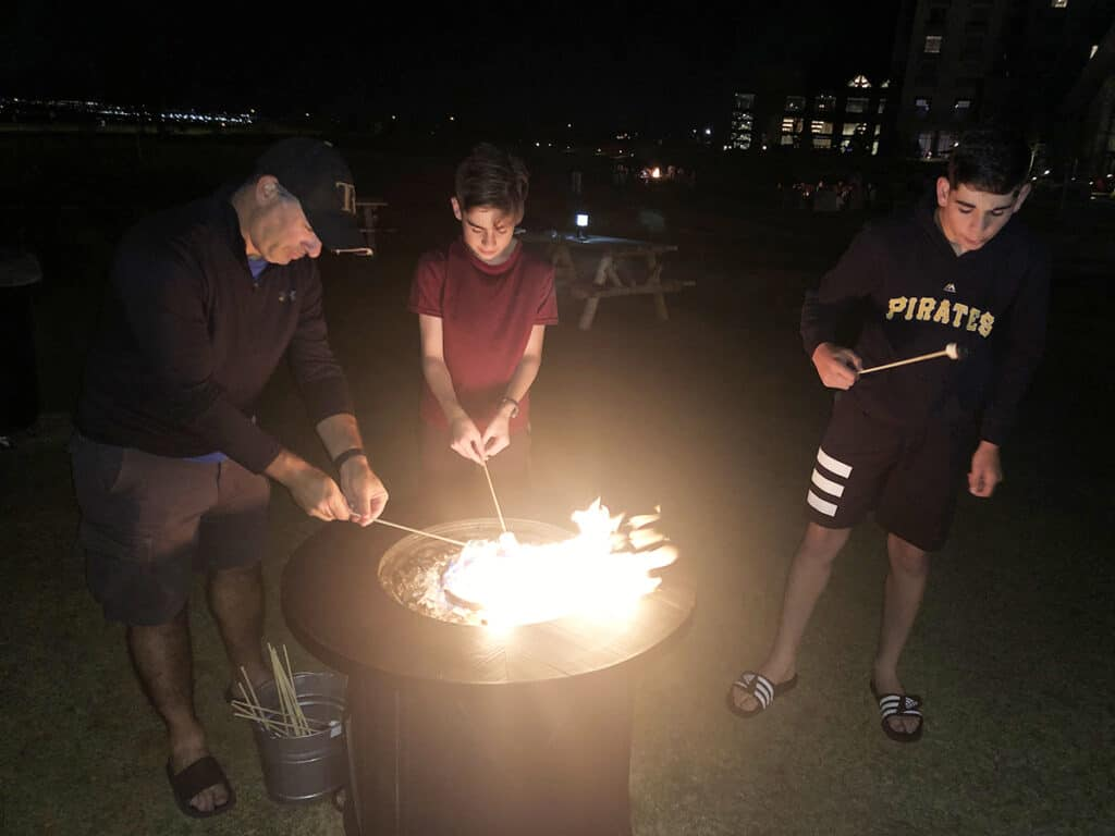 Gaylord Rockies Resort - campfire and smores - father and sons