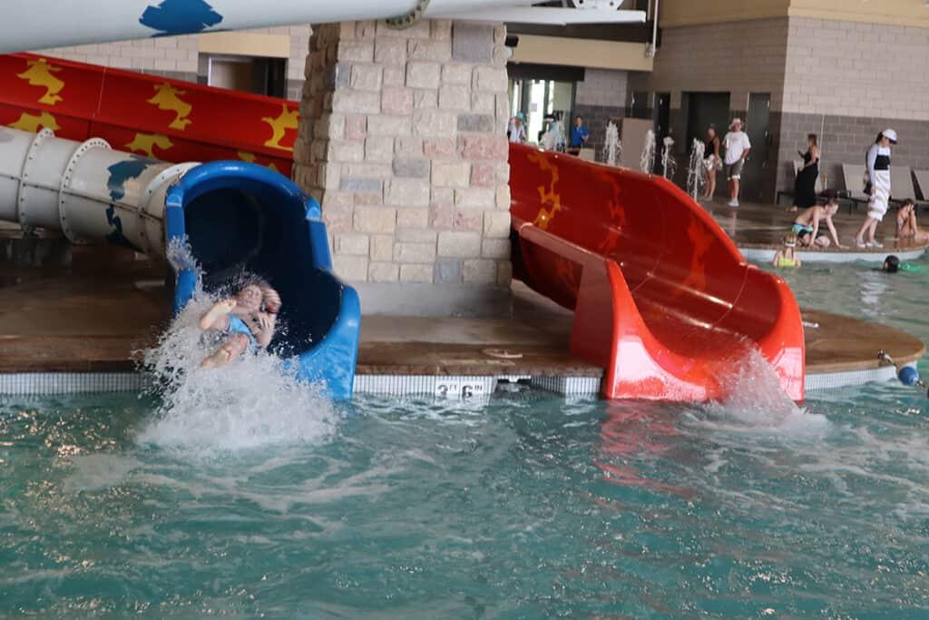 Gaylord Rockies Resort - indoor water slides with teenager boy