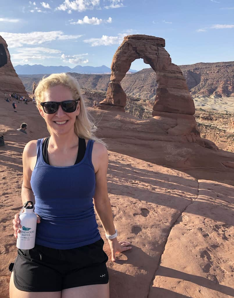 Rachel with Homewood Suites Moab Water Bottle at Delicate Arch