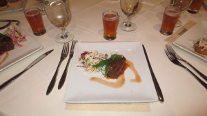 Citrus BBQ short ribs with local Indiana corn cake, red pepper slaw, and blood orange reduction
