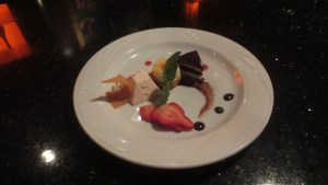 Coconut phyllo tart with strawberry-rhubarb semifreddo, chocolate dacquoise, and cocoa nib