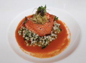 King salmon with bouillabaisse essence, tabbouleh couscous, and melted leeks