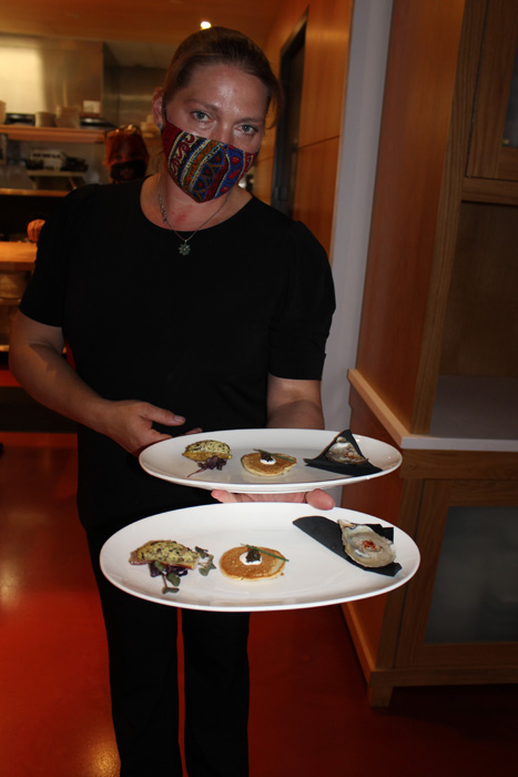 Canapés: whipped deviled potatoes, buckwheat pancake with caviar, and oyster on the half shell