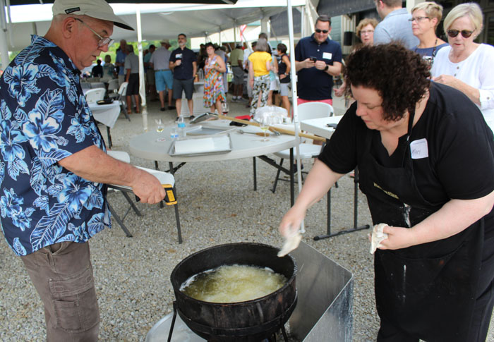 Chefs Dan Morrow and Mary Horn frying fresh perch from Lake Erie