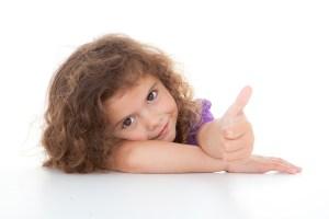bigstock-happy-positive-child-with-thum-33339452
