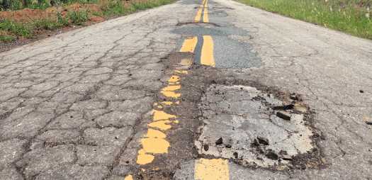bigstock-Damaged-Roadway-Edit-90484274
