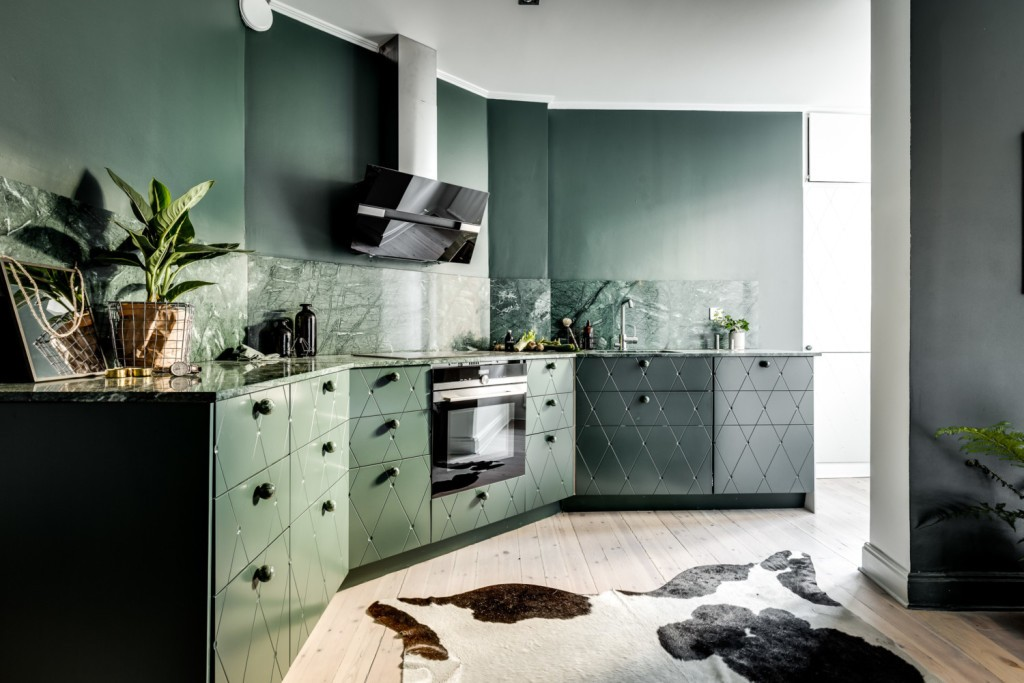 Green kitchen with plants for a biophilic environment. photographed by Henrik Nero