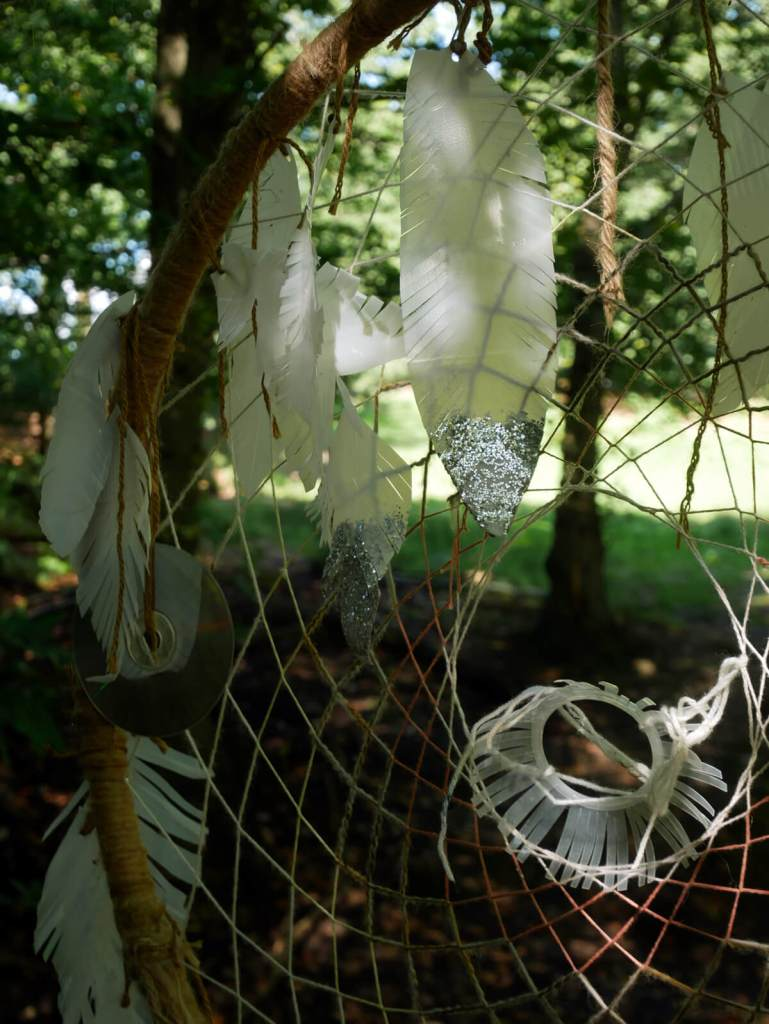 Make your own dream catcher in the woods at Into The Trees family festival. Pippingford Park, Ashdown Forest, Sussex.