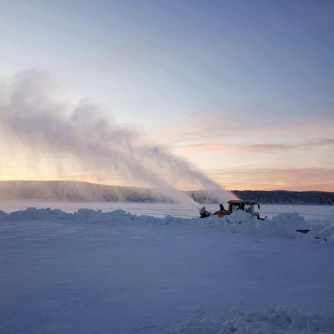 Snow canons at sunset at ICEHOTEL Sweden, helping make the right kind of snow for the construction of ICEHOTEL